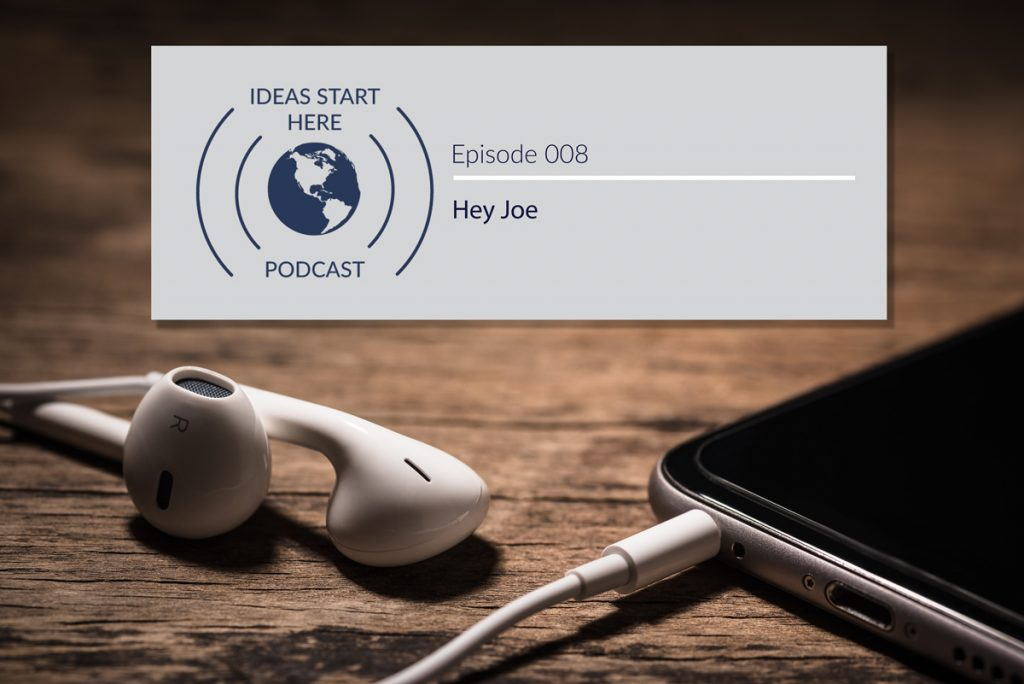 """Earbuds plugged into a smartphone with a sign that says """"Ideas Start Here Podcast Episode 8: Hey Joe"""""""